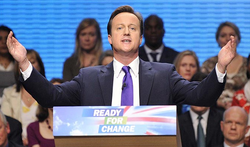 David Cameron Manchester arms stretched