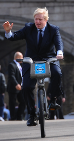 Boris Johnson cycling on bike