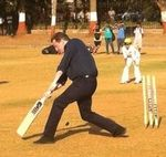 Cameron playing cricket